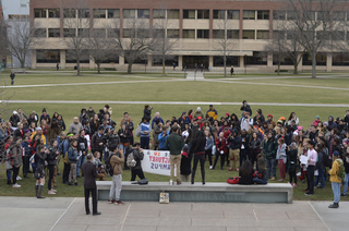 Approximately 100 students gather on the Quad for the Women's Day Sanctuary Campus Rally.